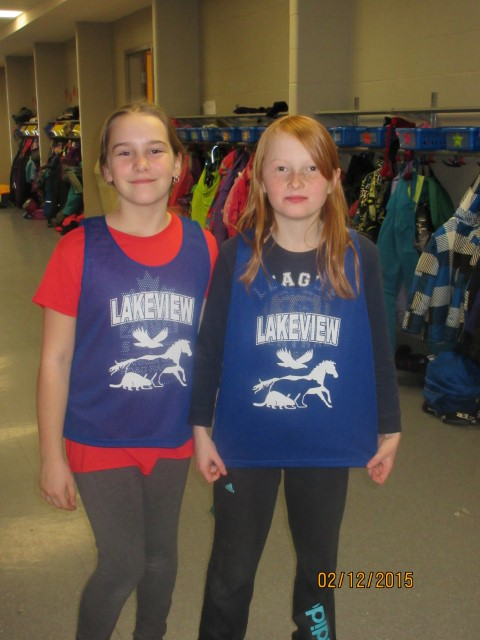 Two Lakeview Students Show Off New Sports Pinnies
