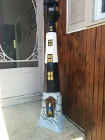 Wood-carved lighthouse